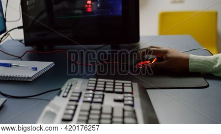 Close Up Of Streamer Holding Rgb Mouse Playing Space Shooter Videogame.