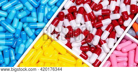 Antibiotic Drugs. Top View Of Painkiller Capsule Pills And Supplements Capsule In Plastic Tray. Phar