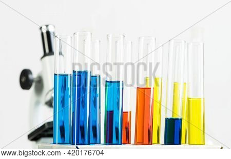 School Chemical Laboratory With Glassware And Microscope. Test Tubes And Flasks With Color Liquid St