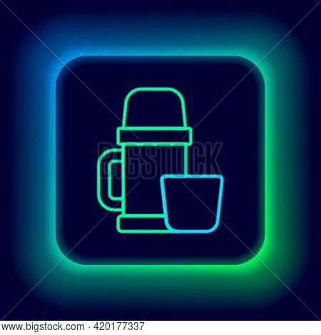 Glowing Neon Line Thermos Container And Cup Icon Isolated On Black Background. Thermo Flask Icon. Ca