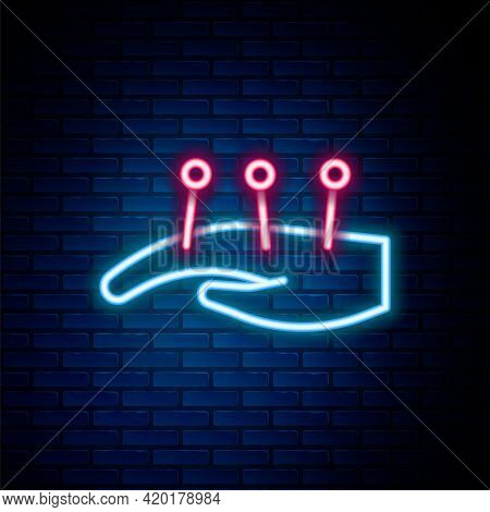 Glowing Neon Line Acupuncture Therapy On The Hand Icon Isolated On Brick Wall Background. Chinese Me