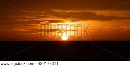 Sunset Over The Sea Or Glowing Sea Sunrise.
