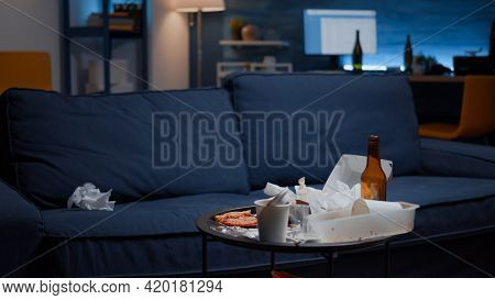 Close Up Of Messy Table With Leftover In Empty Unorganized Living Room