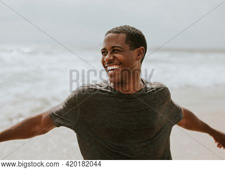 Cheerful man enjoying on the beach