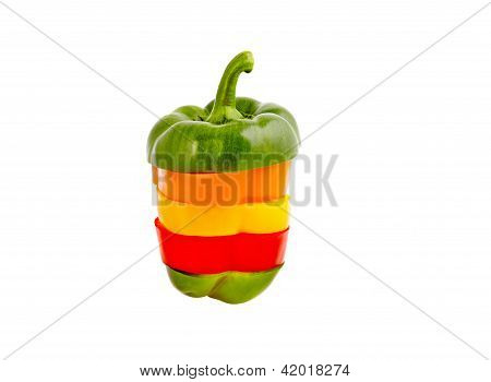 A Sliced Pepper Green, Orange Yellow And Red On A White Background