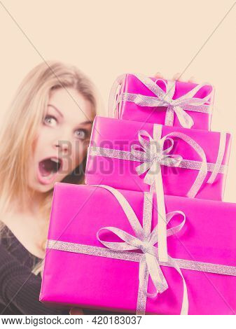 Woman Being Shocked By Amount Of Gifts She Received. Female Having Weirdly Surprised Face Expression