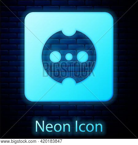 Glowing Neon Electrical Outlet Icon Isolated On Brick Wall Background. Power Socket. Rosette Symbol.