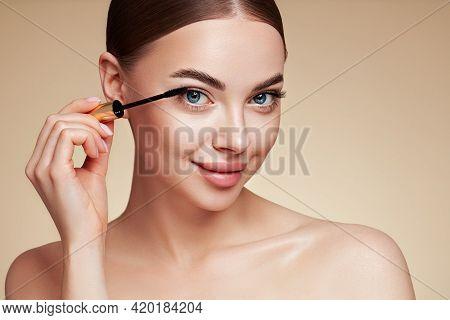 Beauty Woman Applying Black Mascara On Eyelashes With Makeup Brush. Eyelash Extensions. Makeup, Cosm