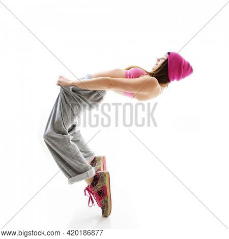 Young girl dancing hip-hip in streetwear at studio on a white background