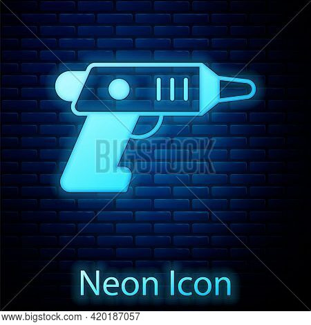 Glowing Neon Electric Cordless Screwdriver Icon Isolated On Brick Wall Background. Electric Drill Ma