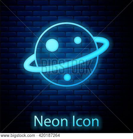 Glowing Neon Planet Saturn With Planetary Ring System Icon Isolated On Brick Wall Background. Vector