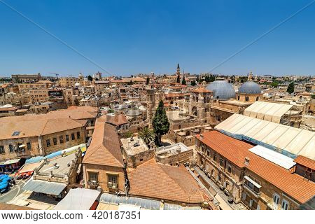 View from above of red roofs, houses, minarets and churches in old city of Jerusalem, Israel.