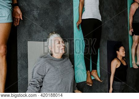 Diverse people in a Savasana pose
