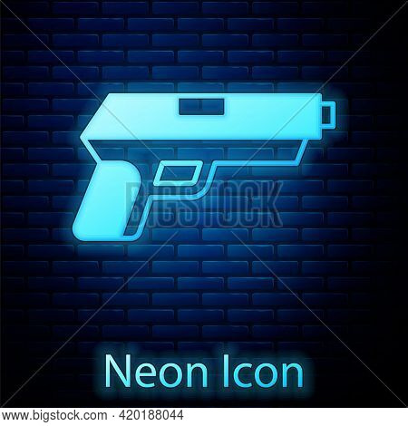 Glowing Neon Pistol Or Gun Icon Isolated On Brick Wall Background. Police Or Military Handgun. Small