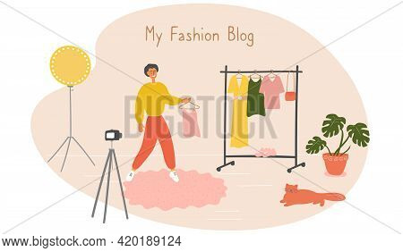 Fashion Blogger Showing Trendy Clothes To Camera. Stylist Influencer Creates Content For Vlog. Young