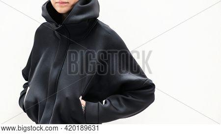Cool woman in a black hoodie