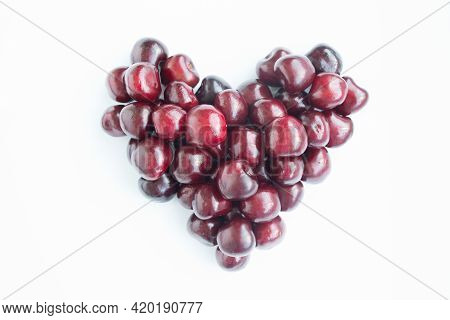 Heart Shaped Red Cherries On A White Background. Background From Cherries. Sweet Cherry Isolated On