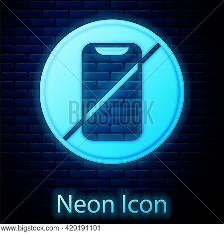 Glowing Neon No Cell Phone Icon Isolated On Brick Wall Background. No Talking And Calling Sign. Cell