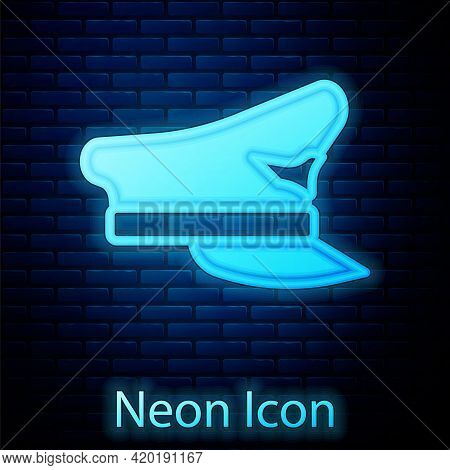 Glowing Neon Pilot Hat Icon Isolated On Brick Wall Background. Vector