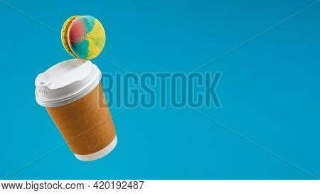 Traditional French Macaron And Coffee Paper Cup Flying On Blue Background Macaron Or Macaroon Hang I