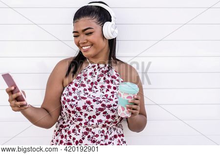 Self Portrait Of Beautiful Young Asian Woman Listening Music And Drinking A Cold Smoothie In Summer