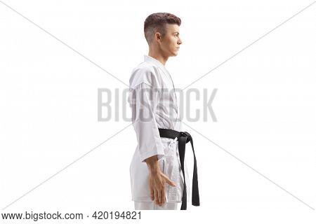 Teenager in karate kimono isolated on white background