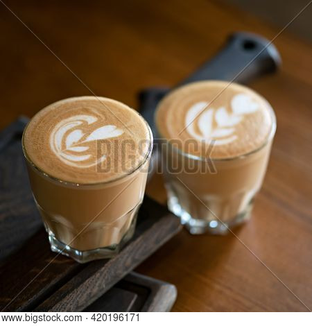 Two Glasses Of Creamy Cappuccino Coffee. Portions Of Hot Aromatic Drink With Froth. Square Format, S