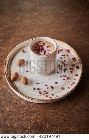 Black Coffee With Sublimated Raspberries In A Ceramic Light Mug On Plate. Nearby Candy Cocoa Beans I