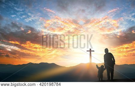 Mom And Daughter Praying And Worship To God On  Mountain Sunset Background