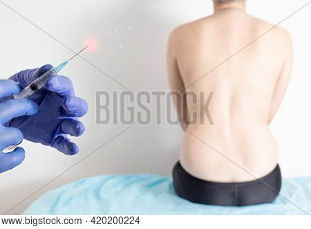 The Doctor Holds In His Hands A Syringe With Anti-inflammatory And Analgesic Medicine For Back Pain.