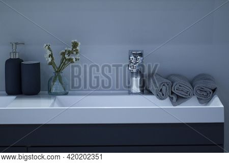 Modern Stylish Washstand With Clean Towels Laid On It In A Clean Bathroom Of A Cozy Apartment Or Hot