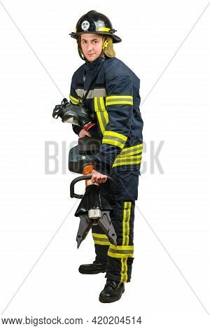 Full Body Young Brave Man In Uniform Of Firefighter Holds Cordless Combined Tool For Spreading, Cutt