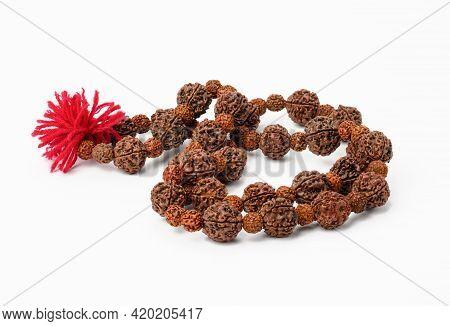 Rudraksha Prayer Beads For Meditation On White Background, Top View. Japa Mala, Close Up