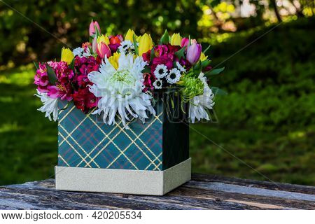 Box with beautiful flovers and white space for text