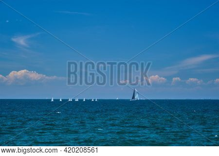 Yacht and RC yach models in sea on summer day. Athens, Greece