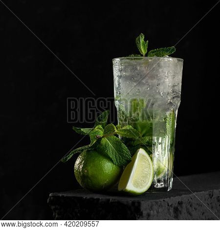 Refreshing Mojito. Fresh Lime Citrus Juice Or Soft Drink With Ice And Mint Leaves. Glass With Dietar