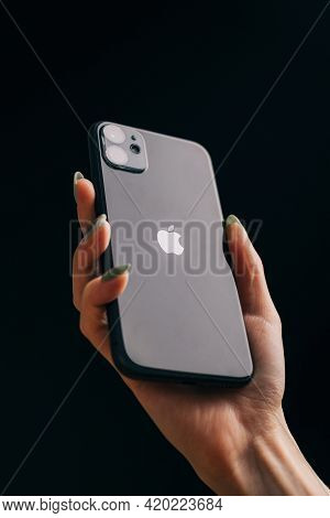 Gelendzhik, Russia, 24 March 2021: A Woman's Hand Holds An Iphone 11 On A Black Background, The Appl