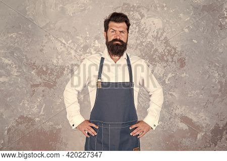 Professional Baker In Apron. Serious Barista With Beard. Advertisement And Food. Cook Wear Professio