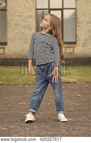 Designing Fashion Beyond Imagination. Little Child With Fashion Look. Small Fashionista In Casual St