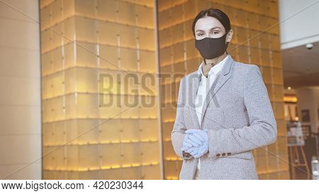 Business Center Receptionist Following The Pandemic Safety Precautions