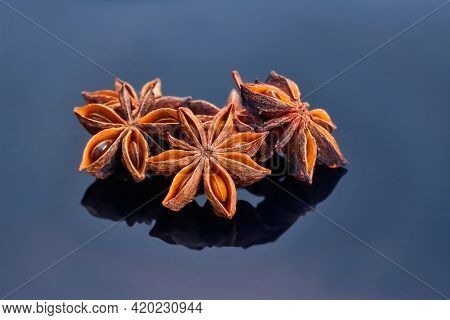 Cardamom, Star Anise, On A Dark Background. And Aroma