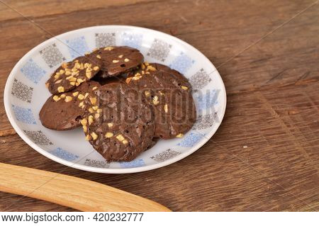 Chocolate Brownie Cookies On White Plate. Malaysian Traditional Cookies Served During Eid Fitri.