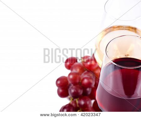 Wine Glasses With Red And White Wine And Grapes