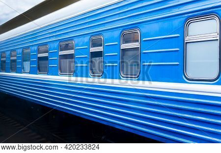 Blue Train Carriage At The Railway Station