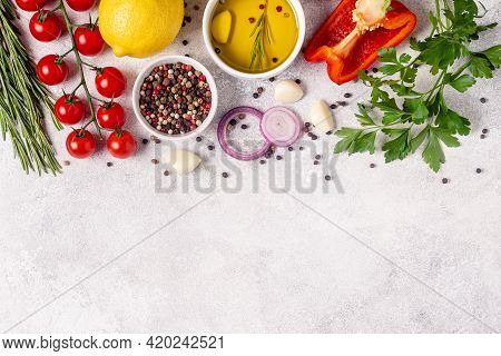 Herbs And Condiments On Light Stone Background. Top View With Copy Space.