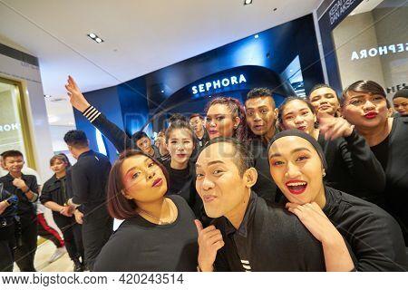KUALA LUMPUR, MALAYSIA - JANUARY 18, 2020: staff posing at Sephora in Fahrenheit 88 shopping mall in Kuala Lumpur.