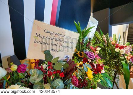 KUALA LUMPUR, MALAYSIA - JANUARY 18, 2020: close up shot of congratulation card with opening ceremony flowers at Sephora store in Fahrenheit 88 shopping mall in Kuala Lumpur.