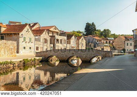 Bridge Over Channel In Vrboska, North Coast Of The Island Of Hvar In Dalmatia, Croatia