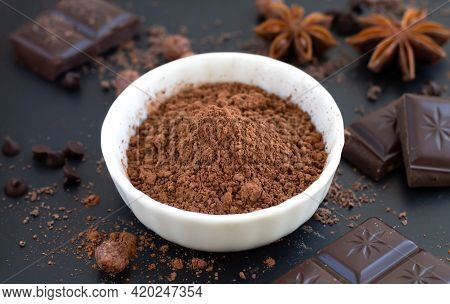 Chocolate Chunks, Cocoa Powder And Spice On Dark Slate Table, Cooking Ingredients