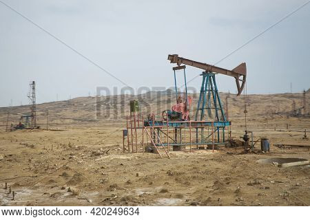 Oil And Gas Drilling Rig Onshore Dessert With Dramatic Cloudscape . Land Oil Drilling Rig Blue Sky .